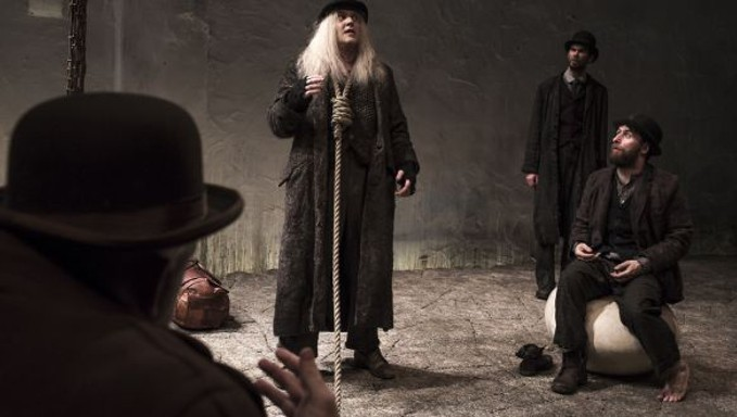 Rory Nolan as Pozzo, Garret Lombard as Lucky, Marty Rea as Vladimir and Aaron Monaghan as Estragon in Druid's production of Waiting for Godot. Photo Matthew Thompson