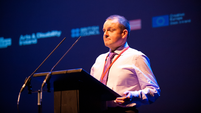 Pádraig Naughton, Executive Director of Arts & Disability Ireland, speaking at the Creative Connections: Arts and Disability Conversation and Showcase in Town Hall Theatre, January 2016. Photo: Reg Gordon.