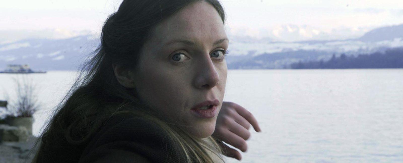 Sarah Ryan performing in Áine Stapleton's Horrible Creature at Lake Zurich.