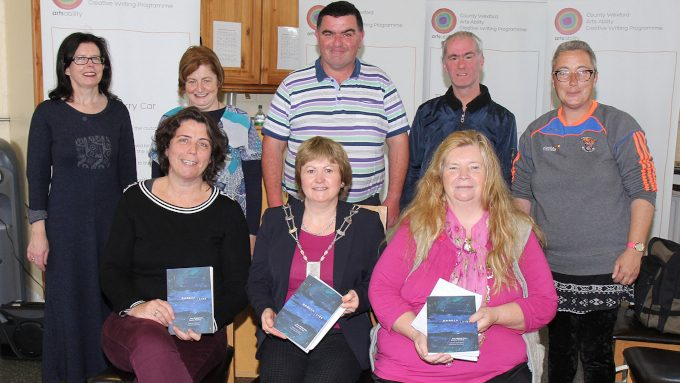 Members of Wexford County Council's Arts Ability creative writing programme and poet Nuala Ní Dhomhnaill, who performed at the official launch of their new publication 'Darker, Later', October 2017.