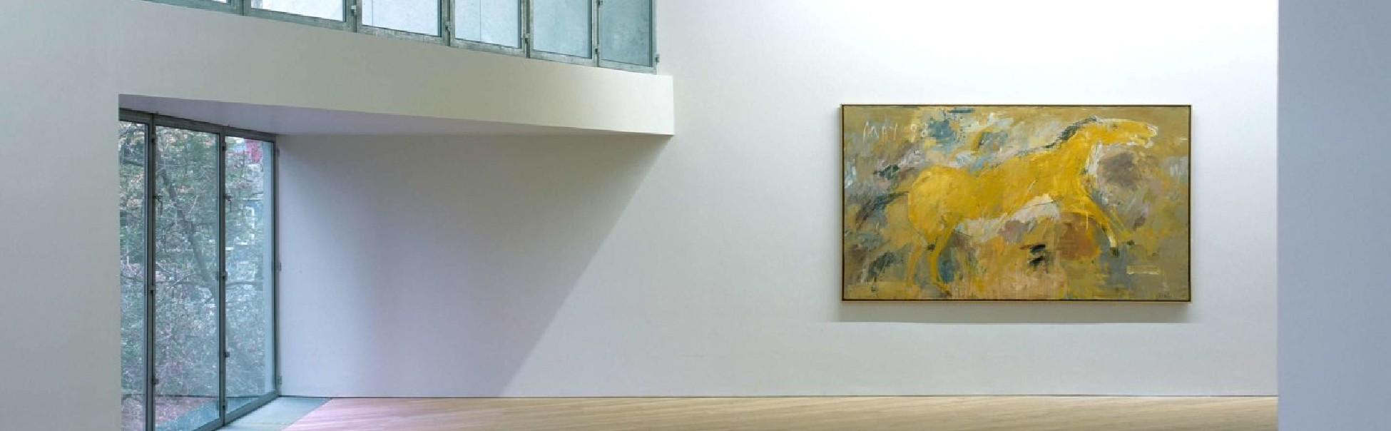 View of the bright first-floor picture window and exhibition in The Glucksman.