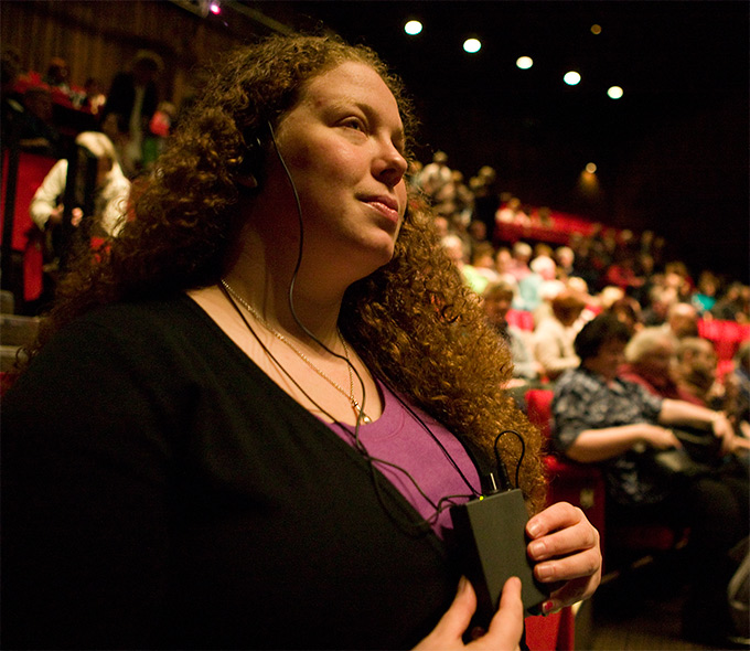 Roisin Dermody listening to audio description of the Abbey Theatre production of The Playboy of the Western World 2007
