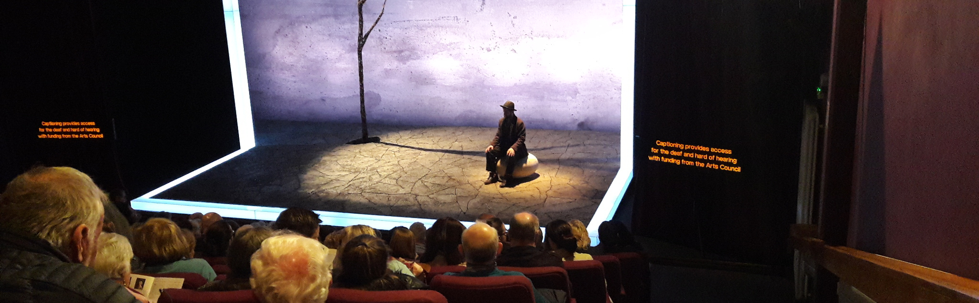 photograph showing captioning units and the set of Druid Theatre Company's Waiting for Godot, Backstage Theatre, 2018.