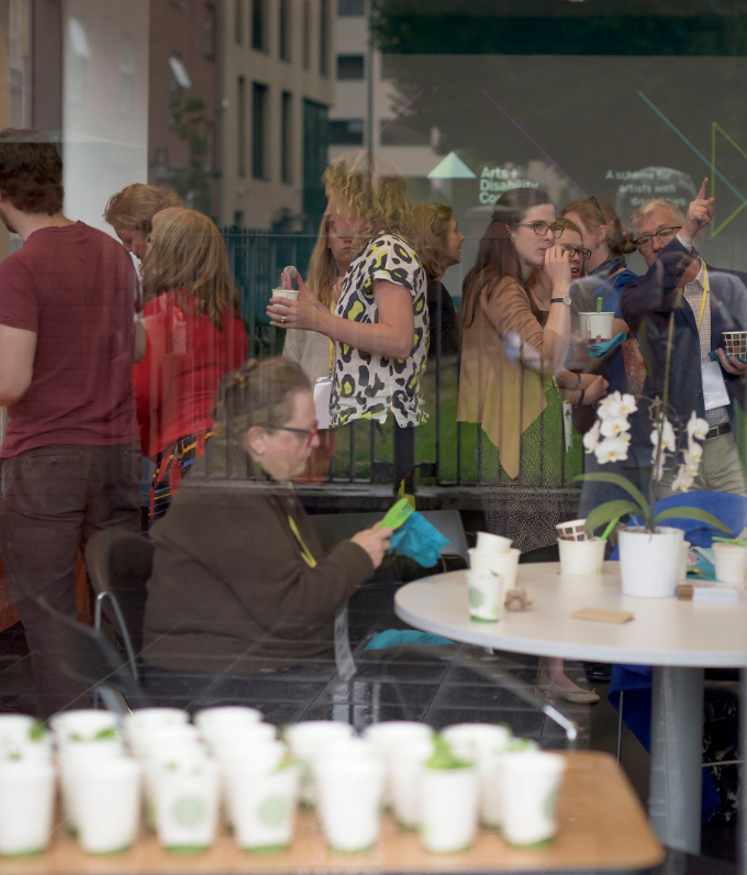 Attendees at the Arts and Disability Connect Professional Development Event, seen from outside DanceHouse. Photo by Louis Haugh.