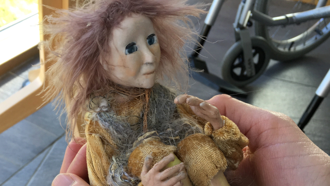 Puppet from the animation 'The Dance of Life' in the hands of Dolores at Dzogchen Beara, 2018. Photo Corina Duyn