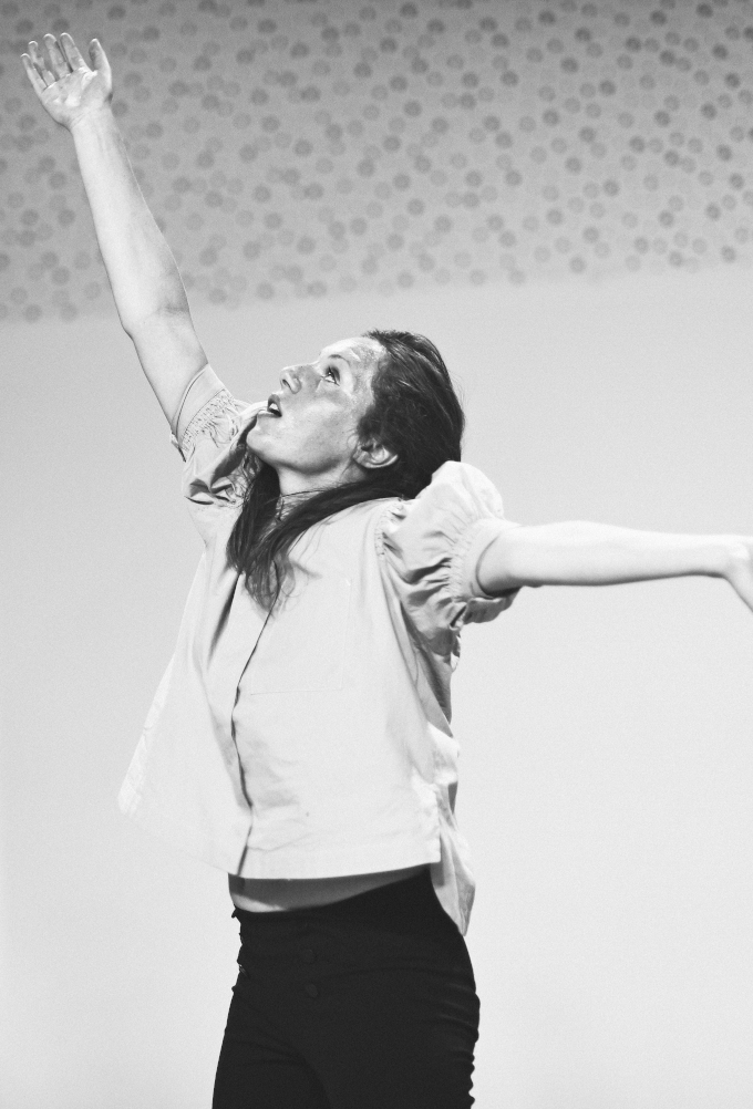 A black and white photograph of Sarah Ryan performing Horrible Creature in a dance studio at DanceHouse.